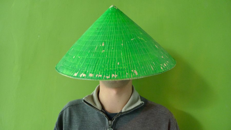 colours in advertising - green colour in China - man with a green hat